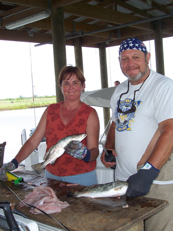 Barbara & Tom Cleaning Fish